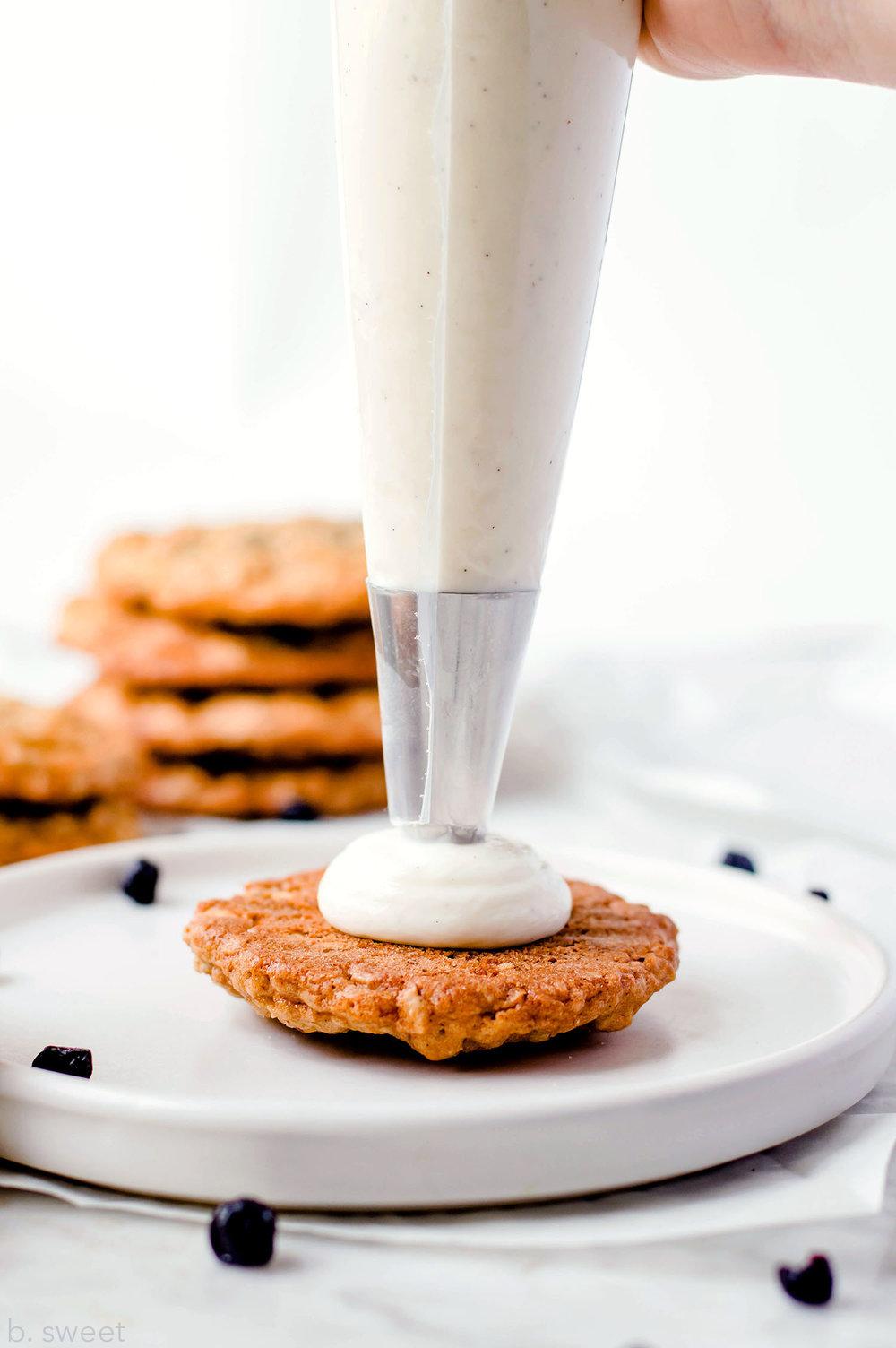 Blueberry Oatmeal Sandwich Cookies with Vanilla Bean Greek Yogurt Filling - b. sweet