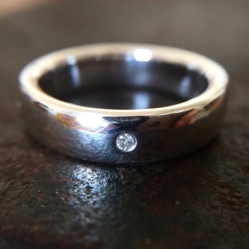 Polished silver band with gipsy set diamond.jpg