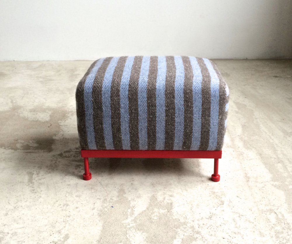 Meet Otto G A foot stool, a small bench, a collaboration with d. furnishings. We bring you this original design wrapped in our One + One wool stripe.