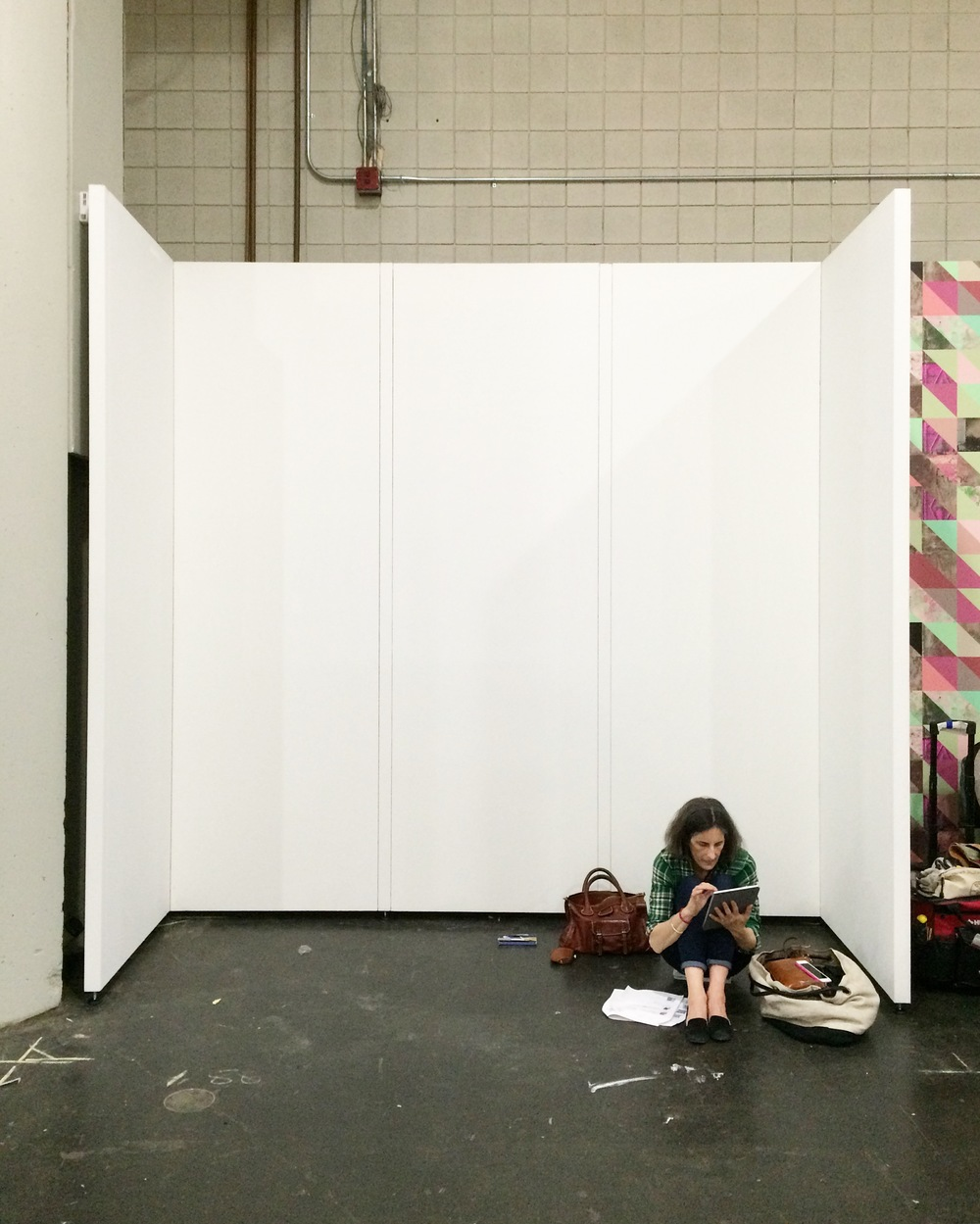 Caroline waiting for our goods to arrive in our booth at ICFF.