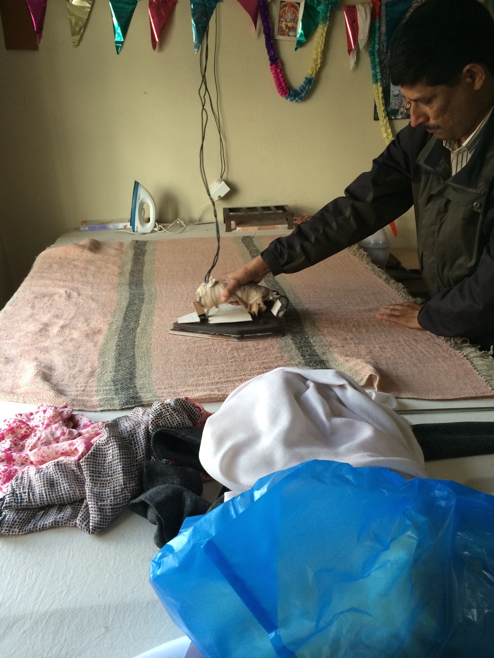 The throws are carefully ironed in Nepal before being packaged and shipped to us. Who said ironing is women's work?