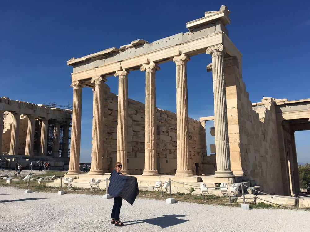A Goldfinch String Stripe shawl visits the Acropolis in Athens with a stylish young customer on a cool spring day.