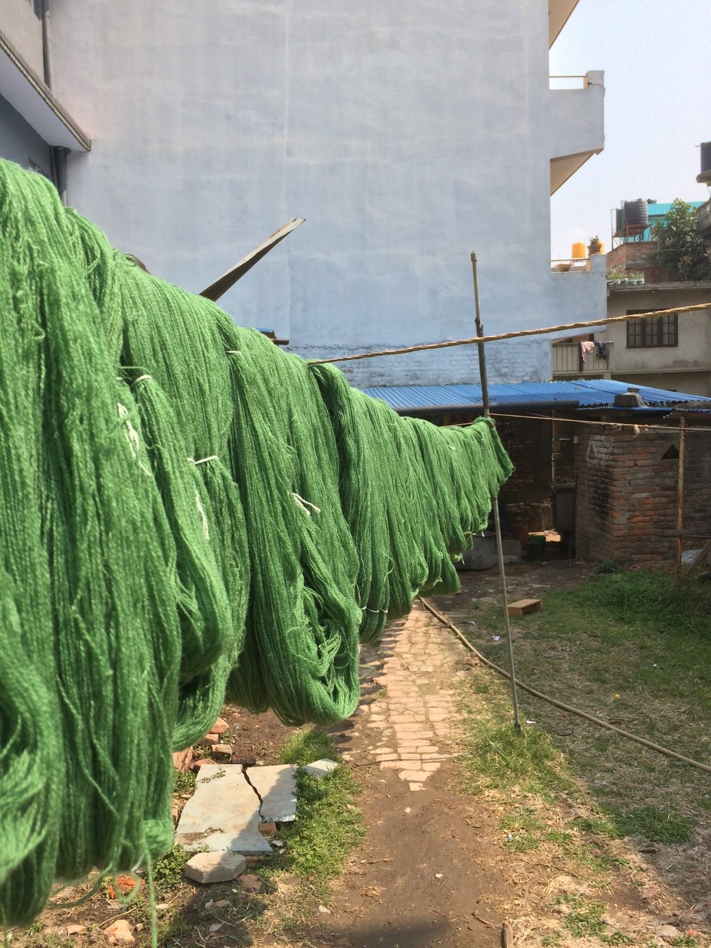 Wool, above, and linen, below, drying in the warm Nepali sun
