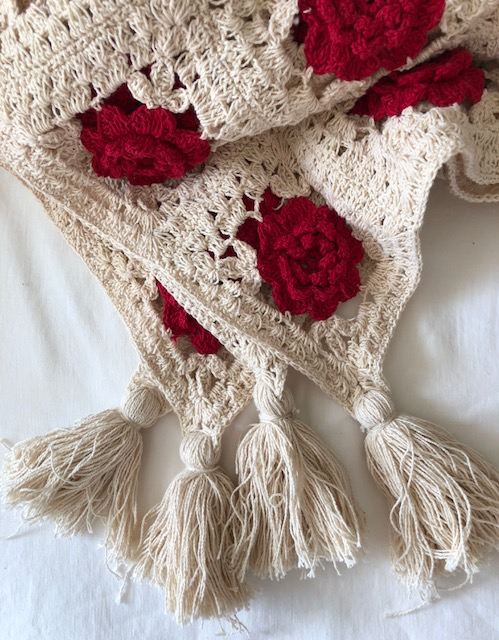 cotton tassels weight the corners of the Wild Roses crocheted throw