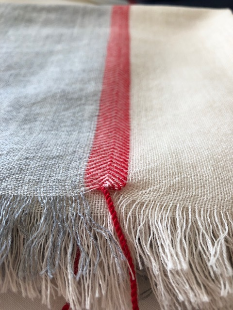the Natural Beauty scarf is handwoven of natural colors with…red!