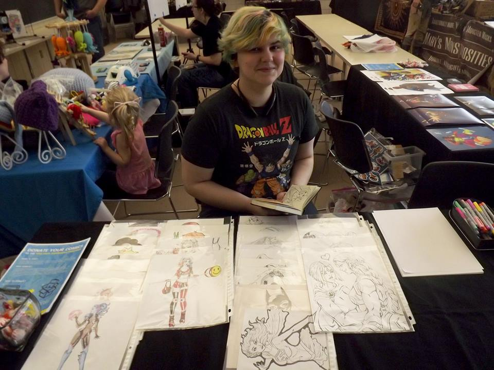 Sam Read selling his work at his first con during Ypsilanti's Washi Con