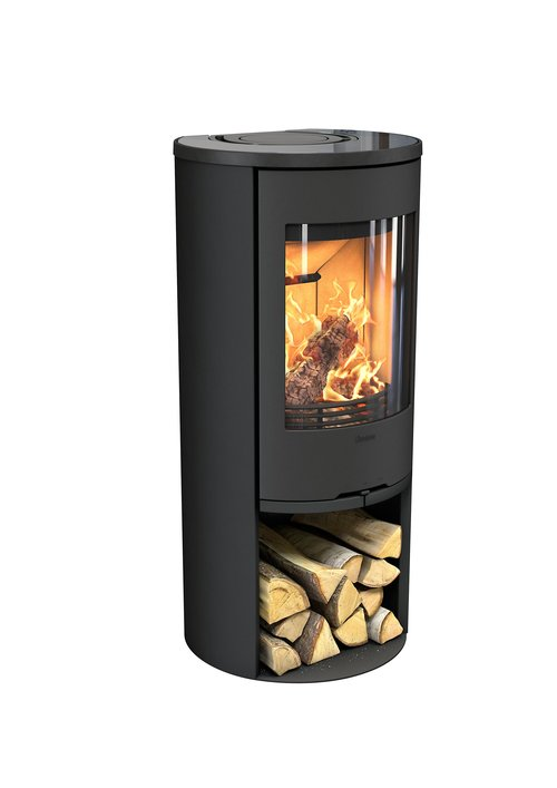 CONTURA 510    The 510 Style stove is perfect to be positioned in a corner. Thanks to its large glass door the heat and light spreads all around the room.   3-7 kW