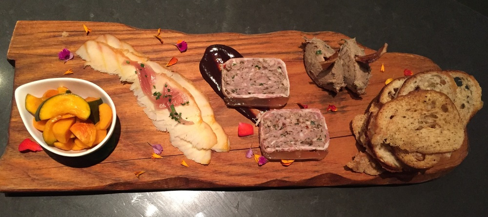 The Harvest Platter Charcuterie Board with Rilettes, Pork Terrine en Croute, Pickled Seasonal Veg, and Smoked Sturgeon.