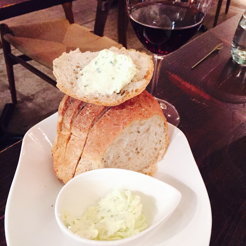 House made Bread and whipped Herb Butter.