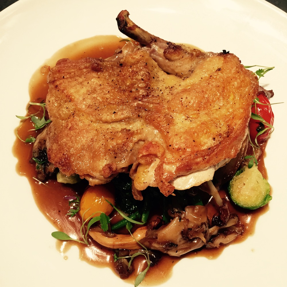 Chantecler Heirloom Roast Chicken with Wild Mushrooms and Seasonal Sautéed Greens.