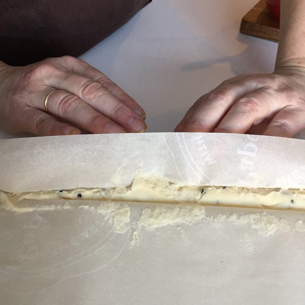 Forming dough into logs.