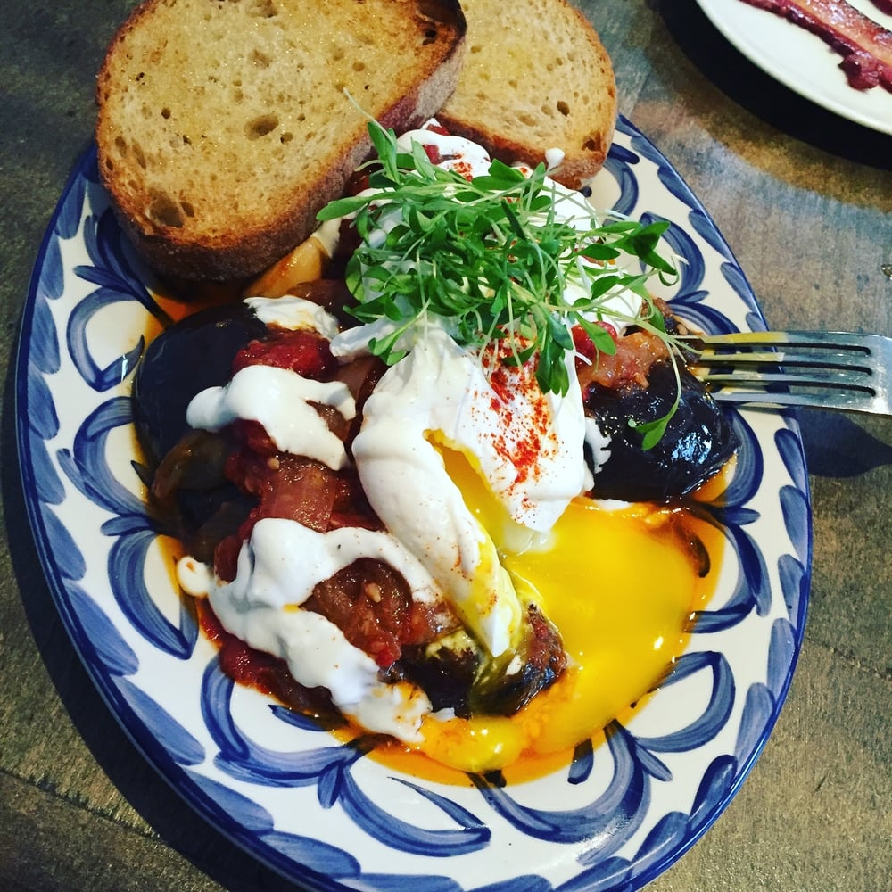 Poached eggs on Eggplant Byaldi.