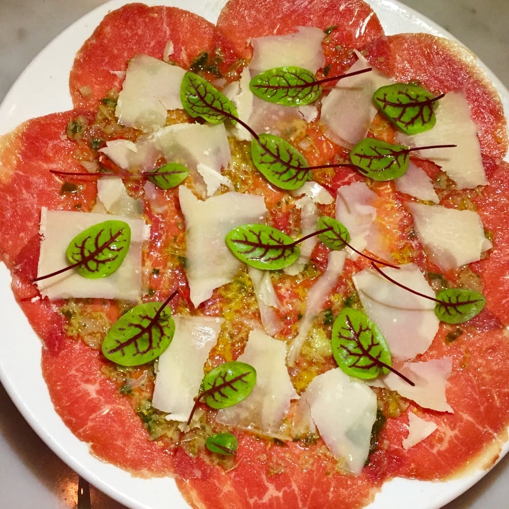 Beef Carpaccio with Celery leaf verde and Parmigiano shavings.