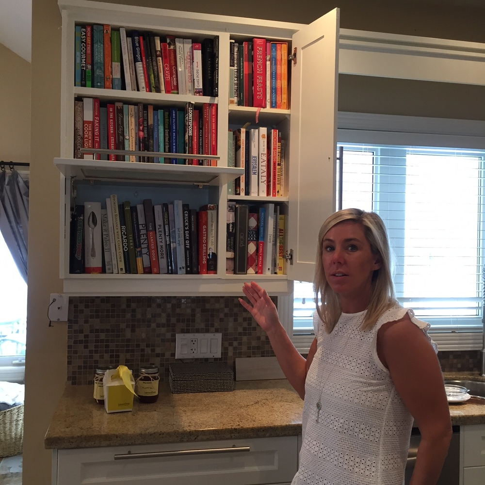 Nancy and a smattering of her giant cookbook collection/