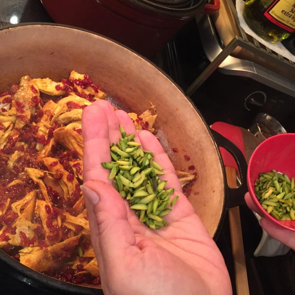 Adding green pistachios.