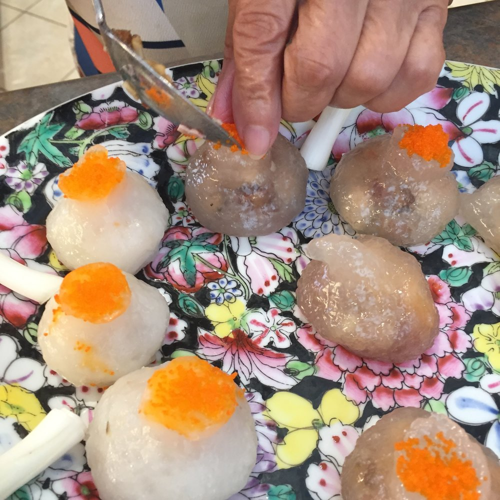 Tapioca dumplings are the darker ones. Such lovely presentation.
