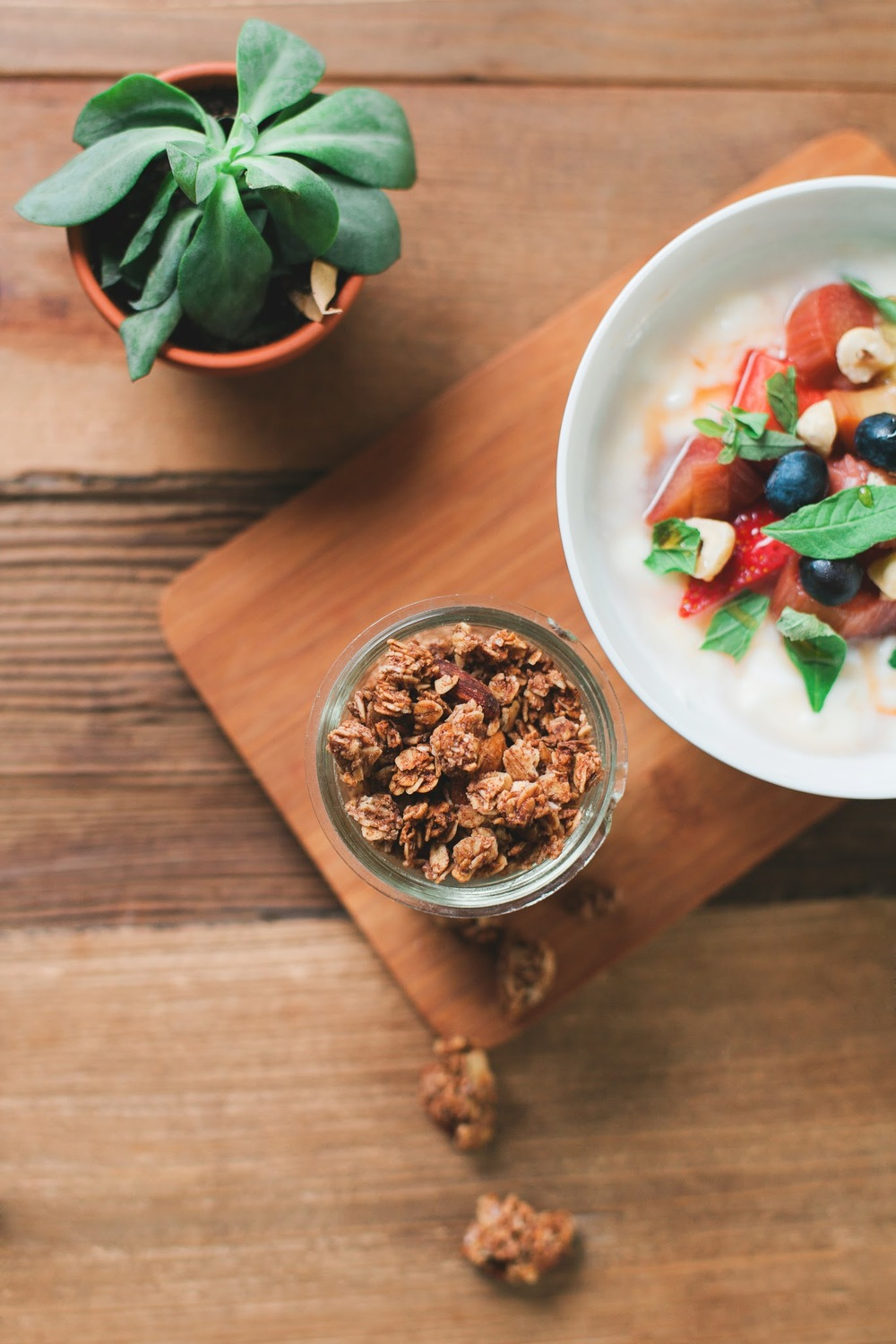 Granola with yogurt, basil, honey roasted rhubarb and strawberries...