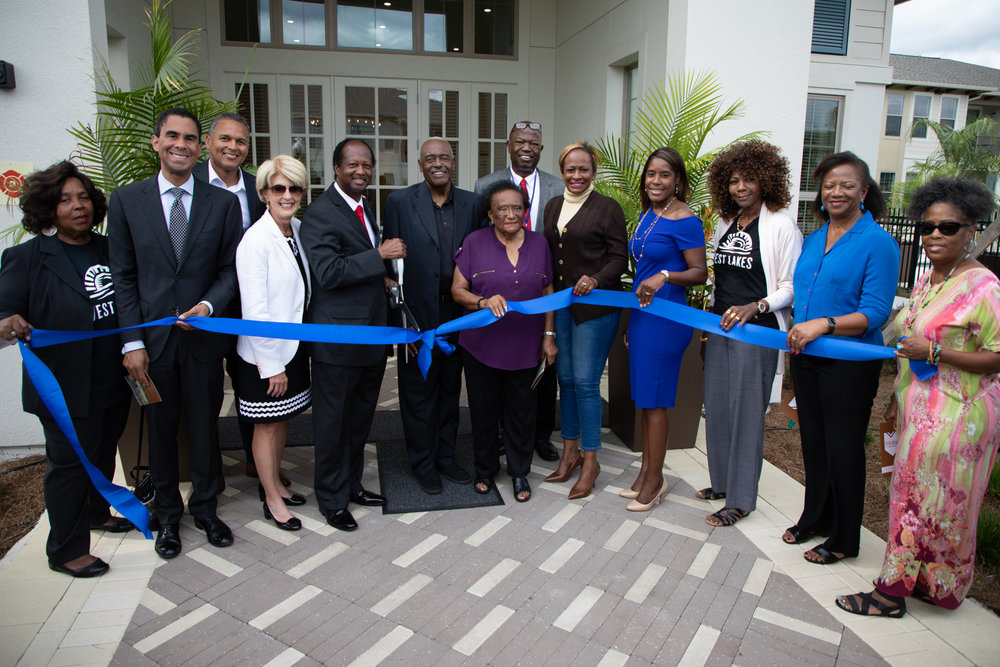 Resident leaders are ready to cut the ribbon!  Photo credit: Talking Head Studio