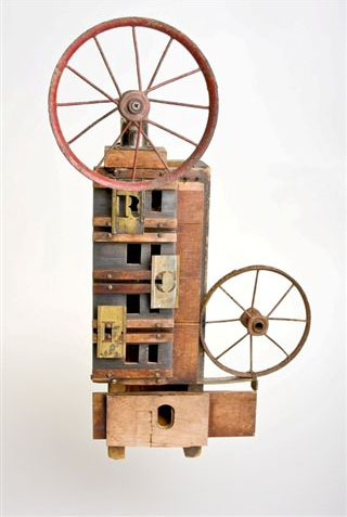 "Mildred Johnson, Calliope, found object assemblage, 22""x12""x7"""