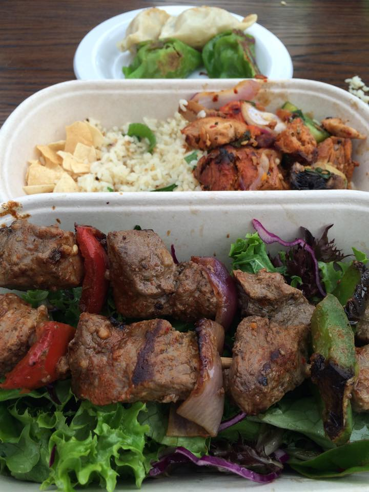 Dumplings, crazy spicy chicken & rice with some beef skewers on a bed of salad.