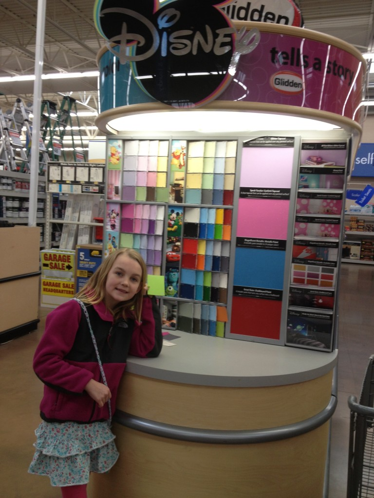 Picking out a Color of Disney Paint at Walmart ~www.thebettermom.com
