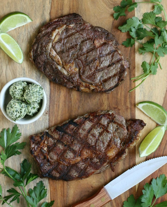 Fire-up the grill for an amazing 30-minute meal! This sensational Grilled Ribeye Steak with Cilantro Lime Chimichurri is as easy as it is delicious!