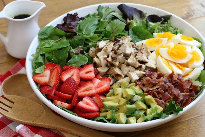 This sweet and savory  Strawberry Cobb Salad  makes a delightful weeknight dinner, or serve it buffet-style for a beautiful dish perfect for summer entertaining!