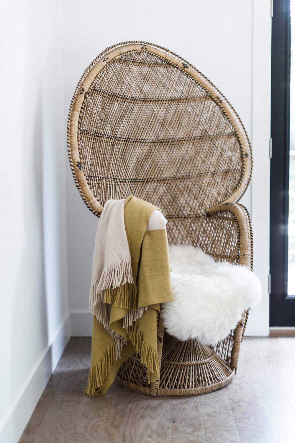 Our peacock chair looks right at home in this bedroom.