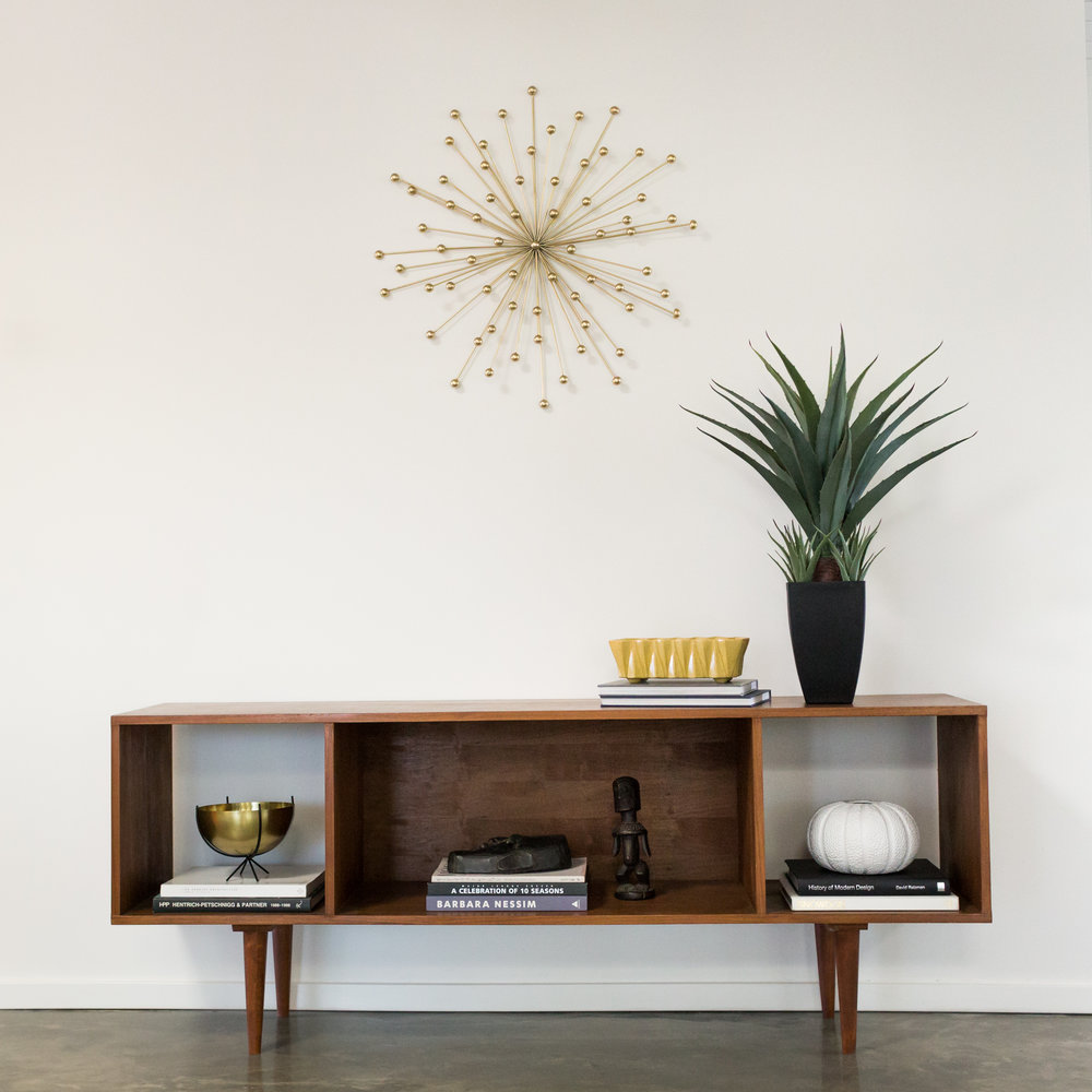 A Mid Century modern credenza, custom-made by Pepe's Furniture in Echo Park, holds court in the entry. And that medallion is EVERYTHING.