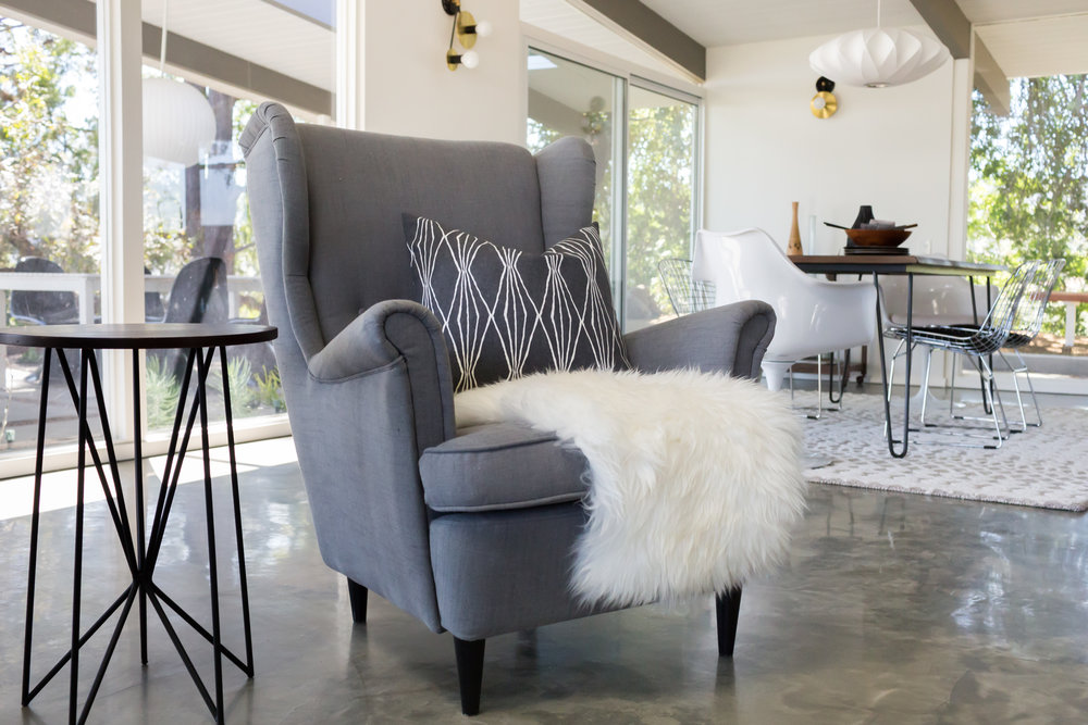 We love how IKEA's Strandmon chair looks right at home here. The pillow's geo pattern echos the side table legs.
