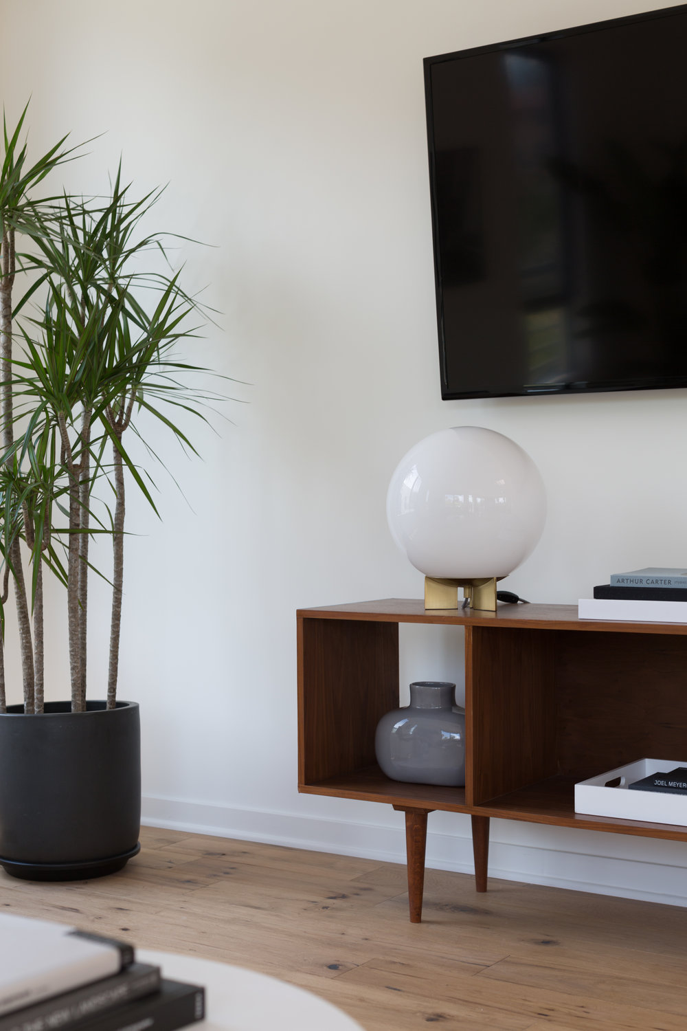 West Elmu0027s Glow Y Globe Table Lamp Echoes The Coffee Tableu0027s Spherical  Lines. A Dragon Plant Has A Dr. Suess Like Feel In The Corner. Pepeu0027s  Furniture In ...