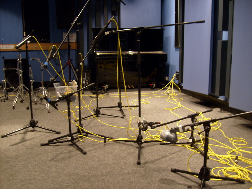 set up drum microphones