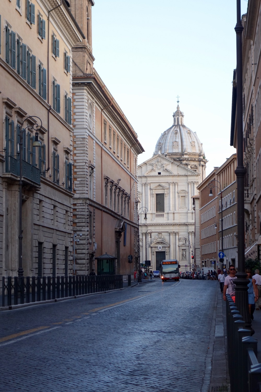 The dome of St. Peter's just casually peaking through the streets.