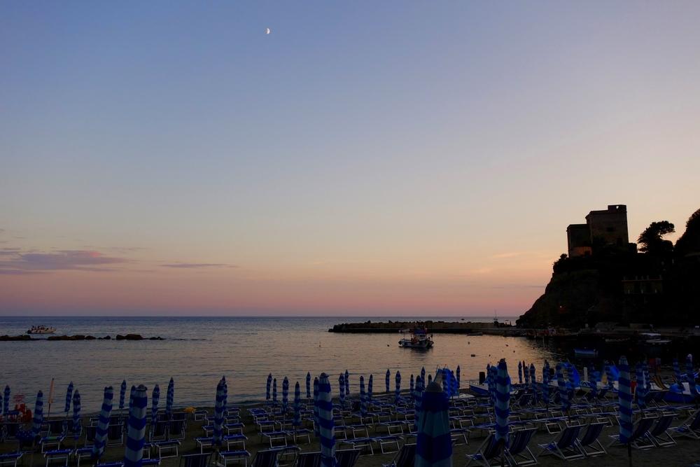 Sunset & beach umbrellas in Monterosso