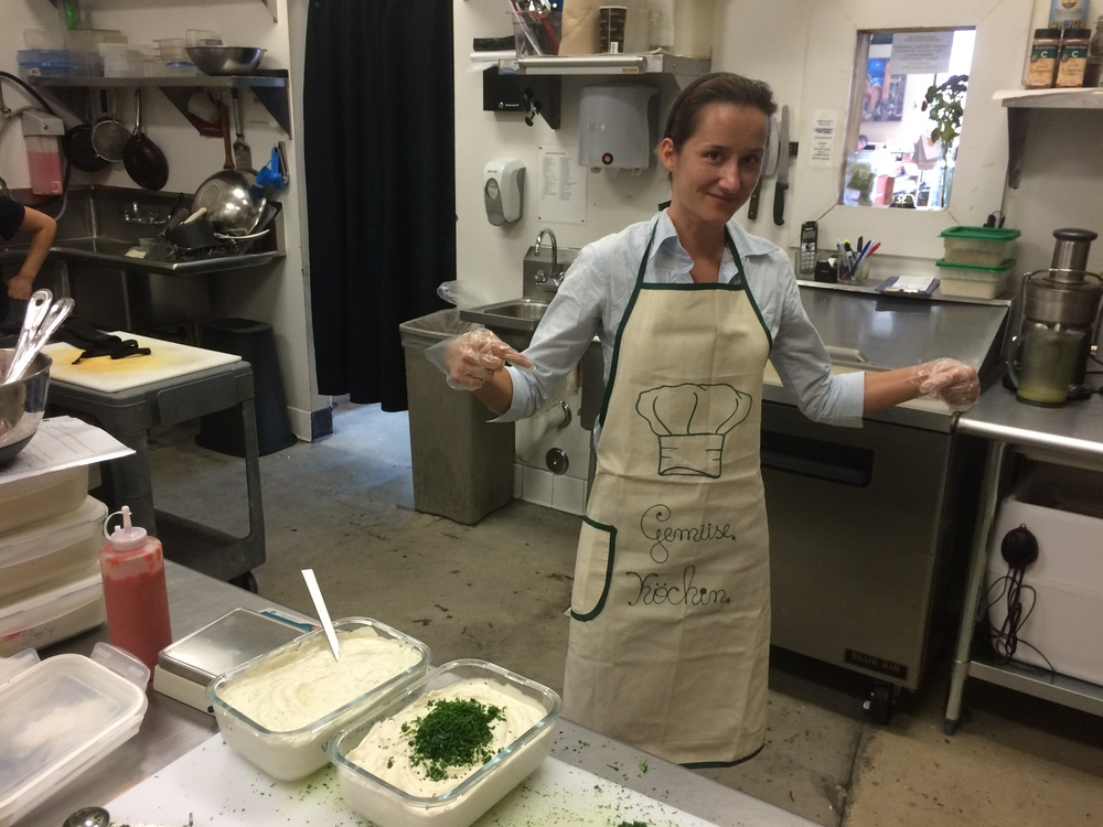 "Maxi making ""Herbie Vore"".   The apron says ´Gemüse Köchin´, german for `Vegetable female chef´ [what a nice gift, thank you Sophia :) ]"