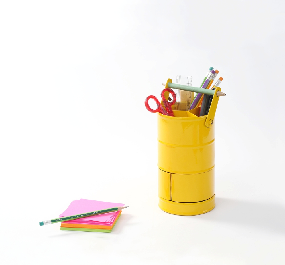 A neat holder that houses everything conceivable to keep your desk absolutely clutter free !