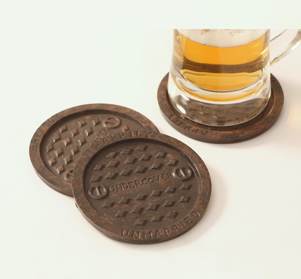A set of 4 coasters to cover all the bad spots on the table. Manhole Coasters by Happily Unmarried Undercover Corp.