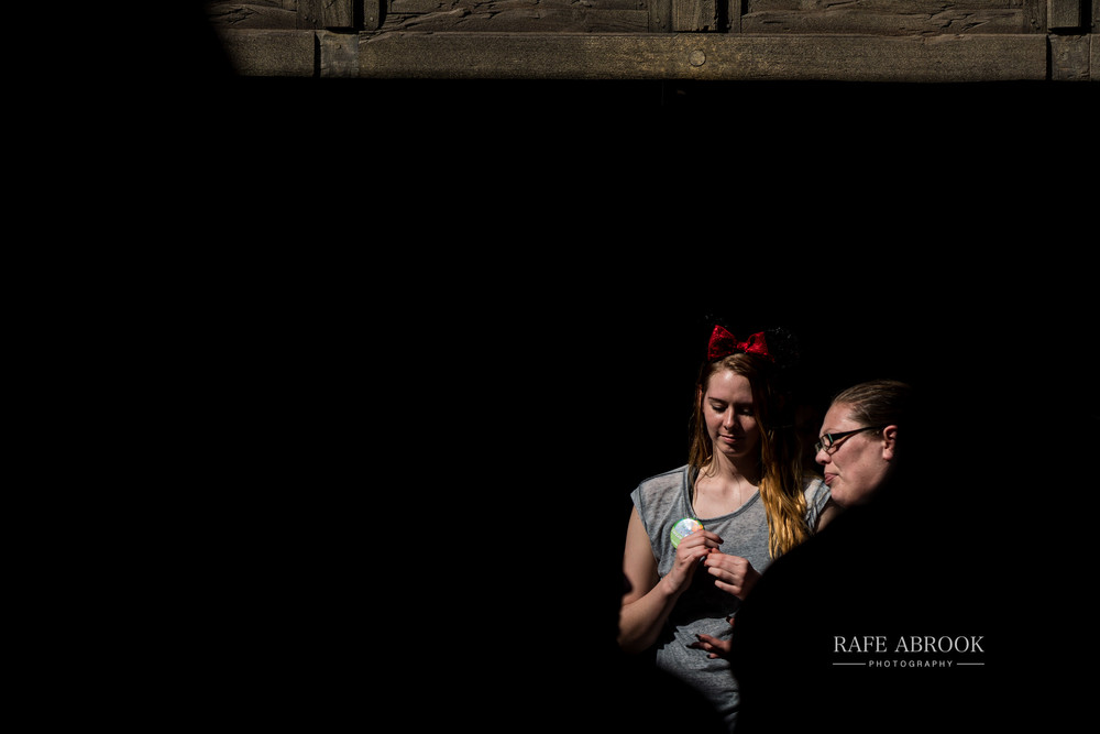 This is what I do the kill the time in queues. I take photos of grown adults in Mickey Mouse ears.