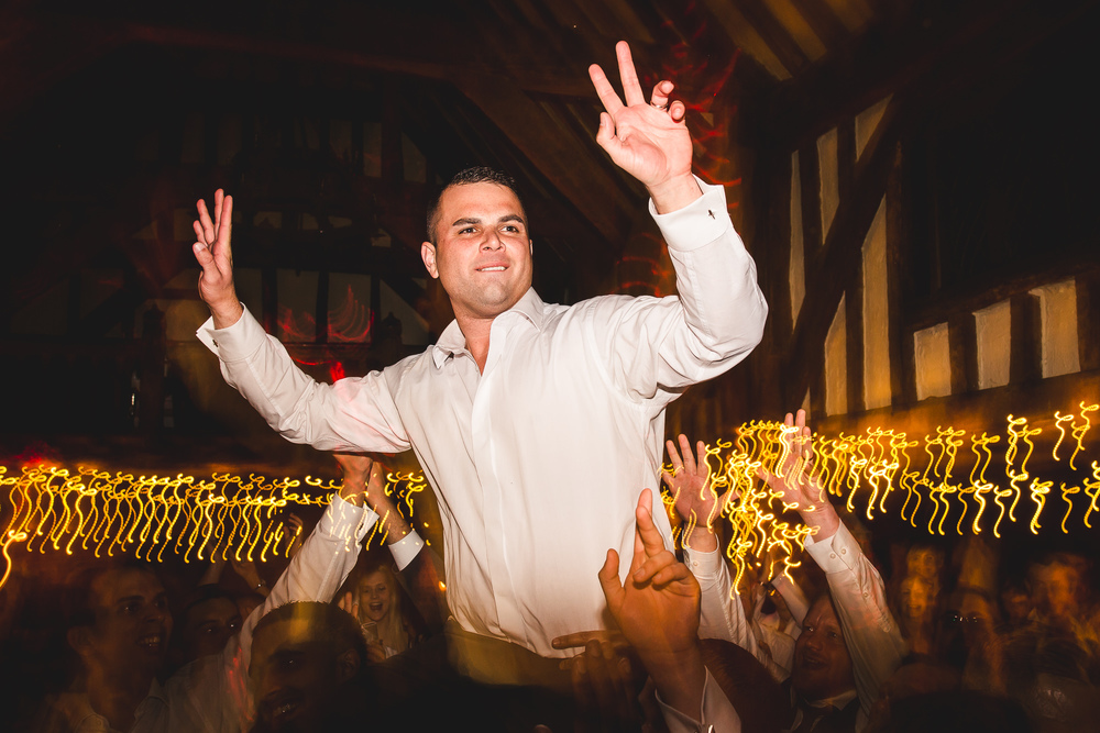This groom lived to consummate his marriage despite a near miss to his right arm