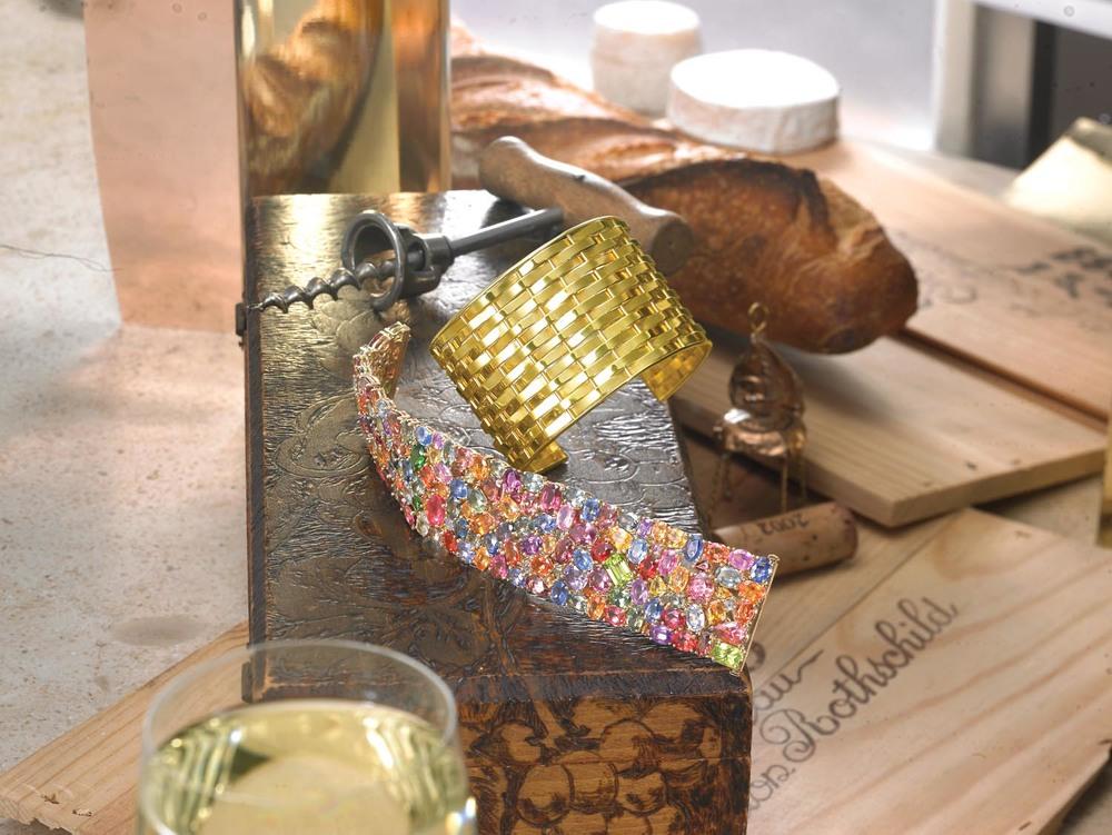 Sapphire, tourmaline and peridot cuff bracelet. Signature woven yellow gold cuff bracelet.