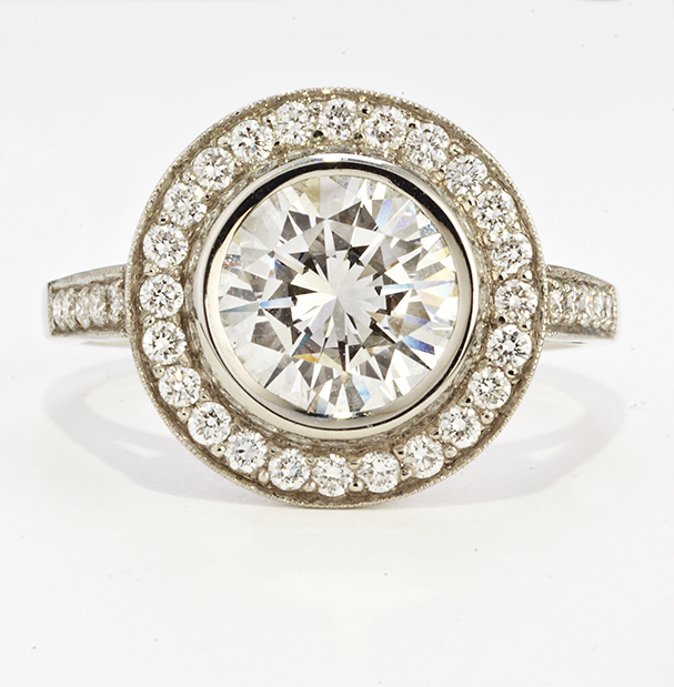 PLATINUM AND BEZEL SET DIAMOND RING