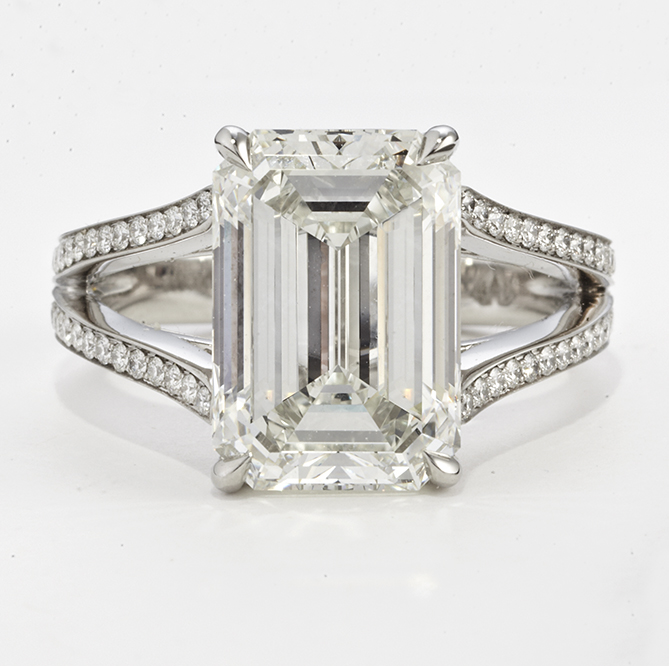 PLATINUM, EMERALD CUT DIAMOND AND DIAMOND RING