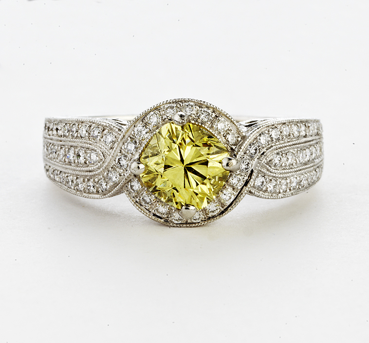 PLATINUM AND CUSHION CUT YELLOW DIAMOND RING