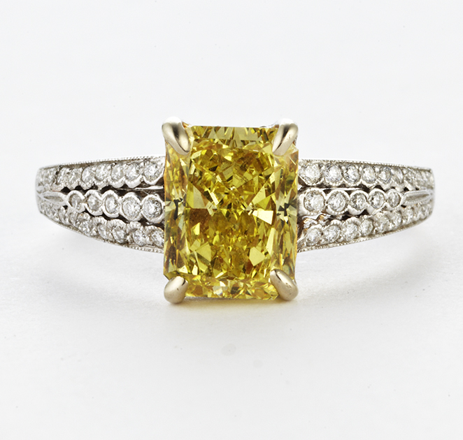 PLATINUM, DIAMOND AND YELLOW DIAMOND RING