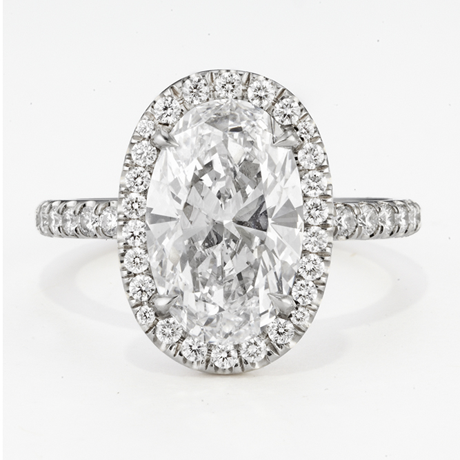 PLATINUM AND OVAL CUT DIAMOND RING
