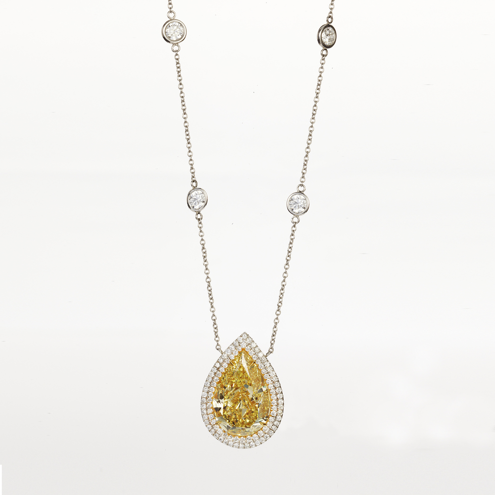 PLATINUM AND FANCY YELLOW DIAMOND PENDANT NECKLACE