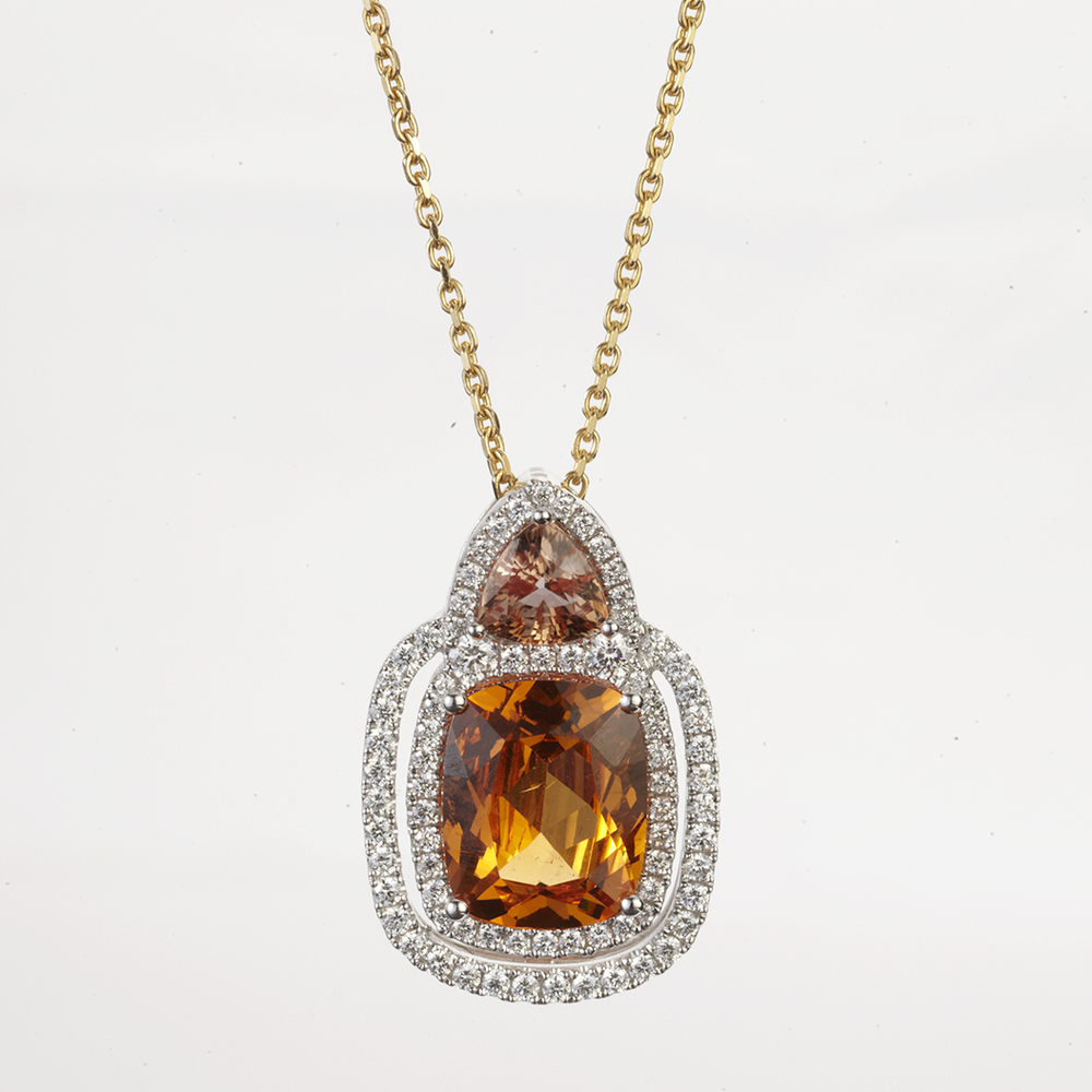 18 KARAT WHITE AND YELLOW GOLD WITH SPESSARTITE GARNET, ORANGE SAPPHIRE AND DIAMOND PENDANT NECKLACE