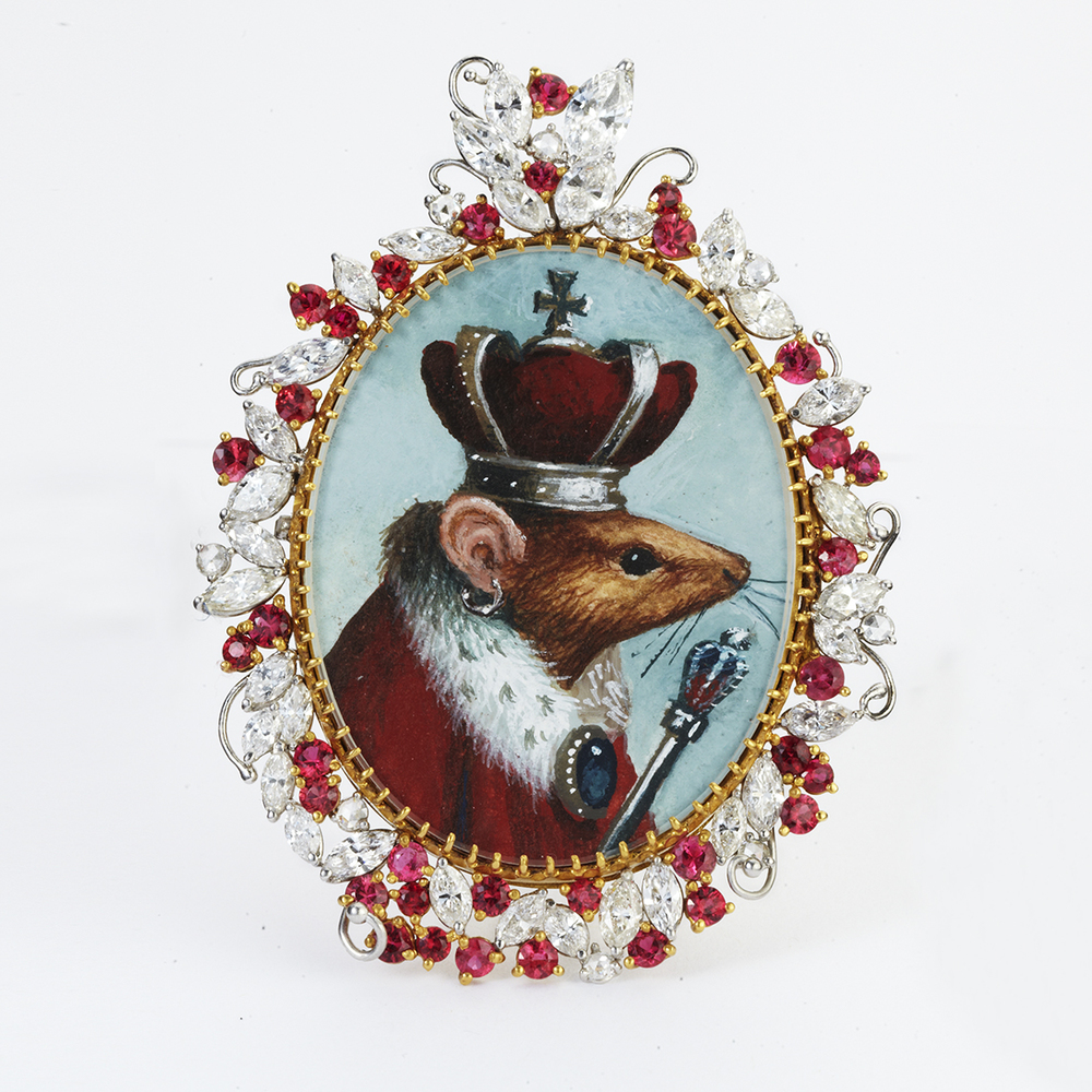 22 KARAT GOLD, PLATINUM, DIAMOND AND ELECTRIC RED SPINEL PORTRAIT BROOCH