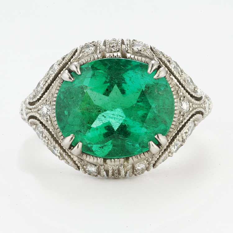 PLATINUM, OVAL EMERALD AND DIAMOND RING