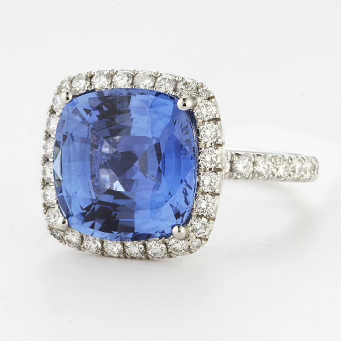 PLATINUM, CUSHION CUT SAPPHIRE AND DIAMOND RING